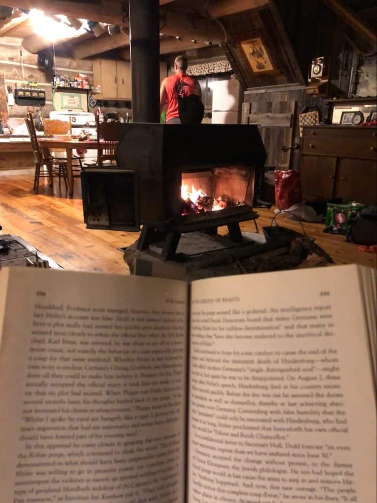 reading a book near a bonfire